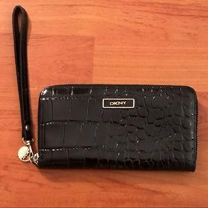 DKNY black shiny black wallet.